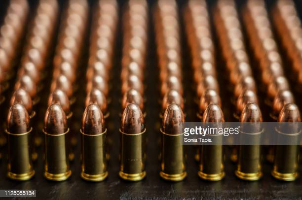 upright bullets in straight rows - ammunition stock pictures, royalty-free photos & images