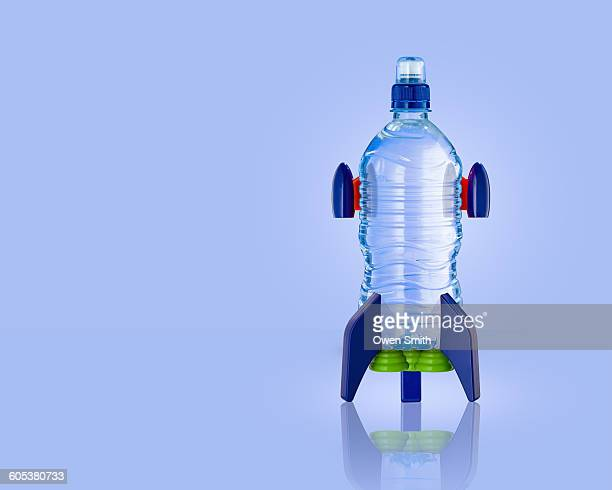 Upright water bottle rocket with blue background