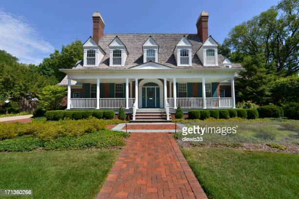 Upscale house with large front garden and paved path