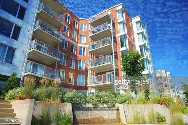 upscale multi-condos building blocks - buzbuzzer stock pictures, royalty-free photos & images