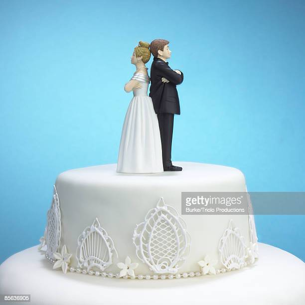 Upset bride and groom cake topper