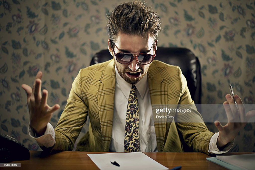 Upset businessman wearing yellow suit : Stock Photo