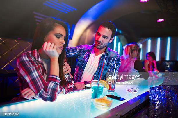 Upset couple not talking to each other in nightclub
