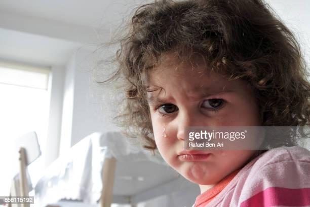 upset little girl - rafael ben ari ストックフォトと画像