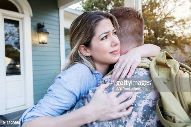 upset military wife dreads her husband's departure - military spouse stock pictures, royalty-free photos & images