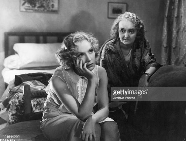 Upset Miriam Hopkins and unidentified actress in a scene from the film 'Men Are Not Gods' 1936