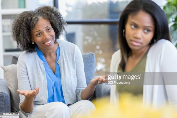 upset mom pleads with wayward daughter - ignoring stock pictures, royalty-free photos & images