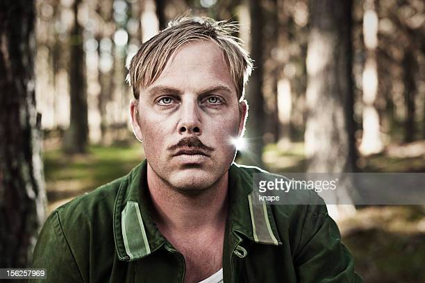 upset soldier in the woods - thin stock pictures, royalty-free photos & images