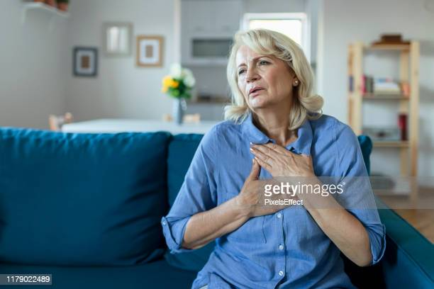 upset stressed older woman feeling heartache - blood vessel stock pictures, royalty-free photos & images
