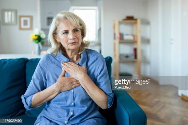 upset stressed older woman feeling heartache - pain stock pictures, royalty-free photos & images