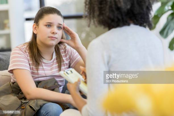 upset teenage girl talks with counselor - vulnerability stock pictures, royalty-free photos & images