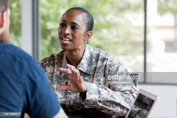 upset veteran talks with counselor - post traumatic stress disorder stock pictures, royalty-free photos & images