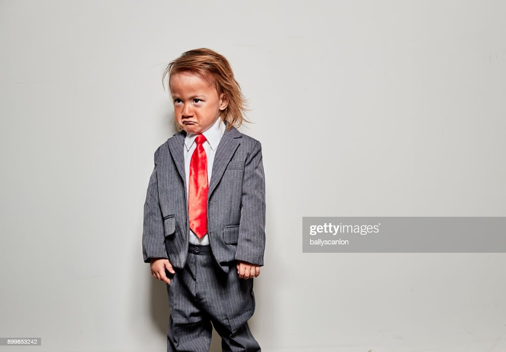 Young Boy Dressed Up As Donald Trump For Halloween : Stock Photo