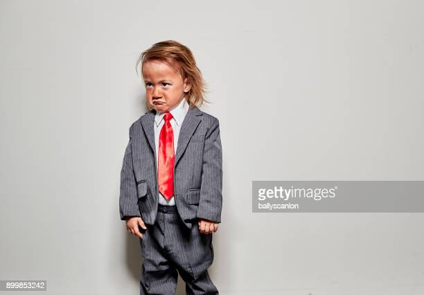 young boy dressed up as donald trump for halloween - donald trump funny face stock pictures, royalty-free photos & images