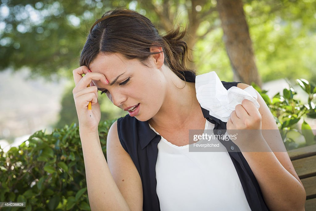 Upset Young Woman with Pencil and Crumpled Paper in Hand : Stock Photo