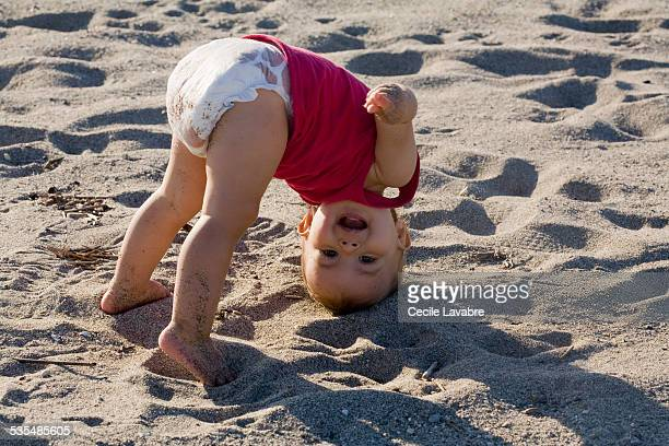 upside down baby girl at the beach - bent over babes stock pictures, royalty-free photos & images