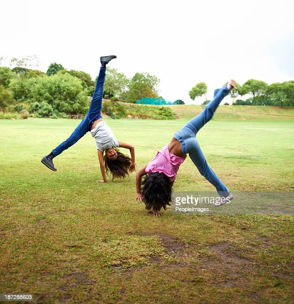 upside down fun - cartwheel stock pictures, royalty-free photos & images