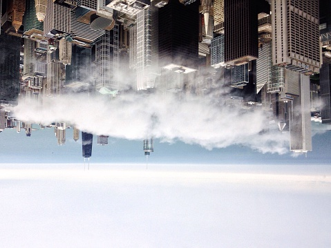 Upside Down Image Of Cityscape Against Cloudy Sky - gettyimageskorea