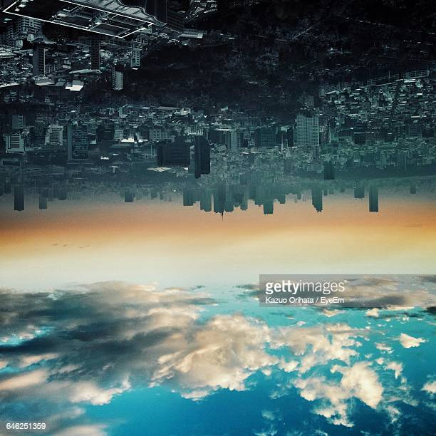 Upside Down Image Of Cloudy Sky And Cityscape