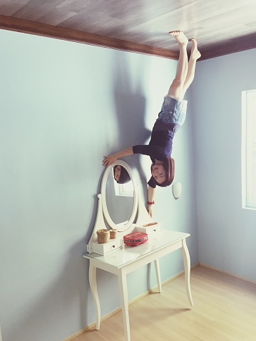 Upside Down Image Of Woman On Dressing Table At Home - gettyimageskorea