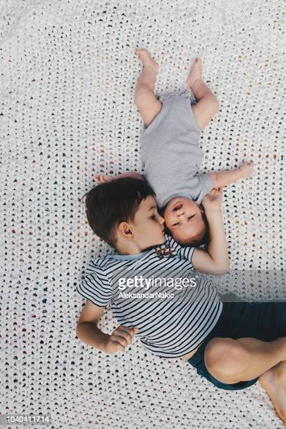 upside down - sibling stock pictures, royalty-free photos & images
