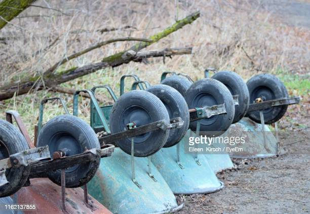 upside down wheelbarrows on land - eileen kirsch stock pictures, royalty-free photos & images