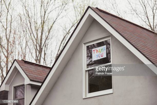 upstairs window in home shows hand painted thank you sign in glass window - thank you stock pictures, royalty-free photos & images