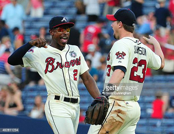 B J Upton and Chris Johnson of the Atlanta Braves celebrate after the game against the San Diego Padres at Turner Field on July 27 2014 in Atlanta...