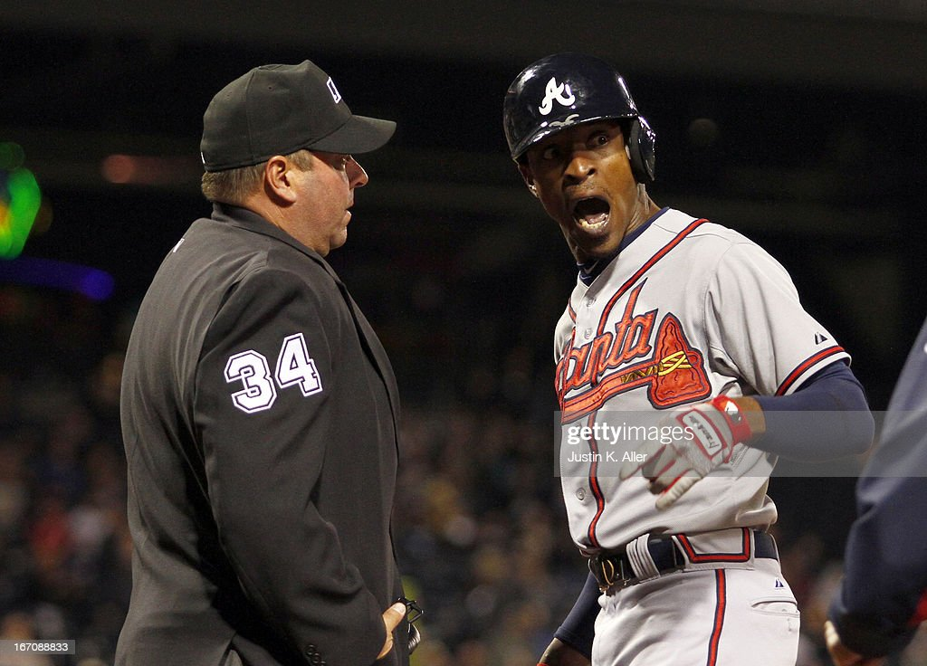 B.J. Upton #2 of the Atlanta Braves argues with home plate umpire Sam Holbrook after a strikeout in the seventh inning against the Pittsburgh Pirates during the game on April 19, 2013 at PNC Park in Pittsburgh, Pennsylvania.
