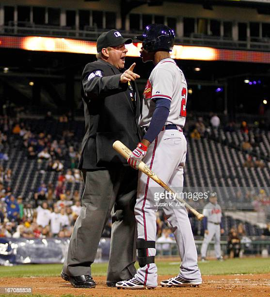 J Upton of the Atlanta Braves argues with home plate umpire Sam Holbrook after a strikeout in the seventh inning against the Pittsburgh Pirates...