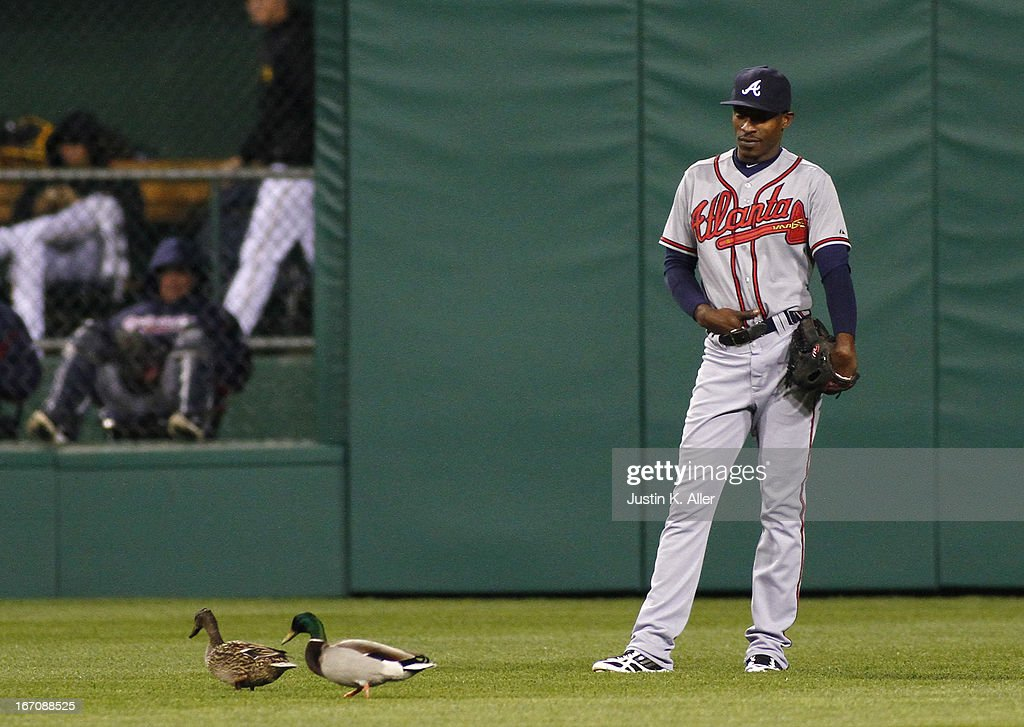 B.J. Upton #2 of the Atlanta Braves looks on while two ducks pass by during the game against the Pittsburgh Pirates on April 19, 2013 at PNC Park in Pittsburgh, Pennsylvania.