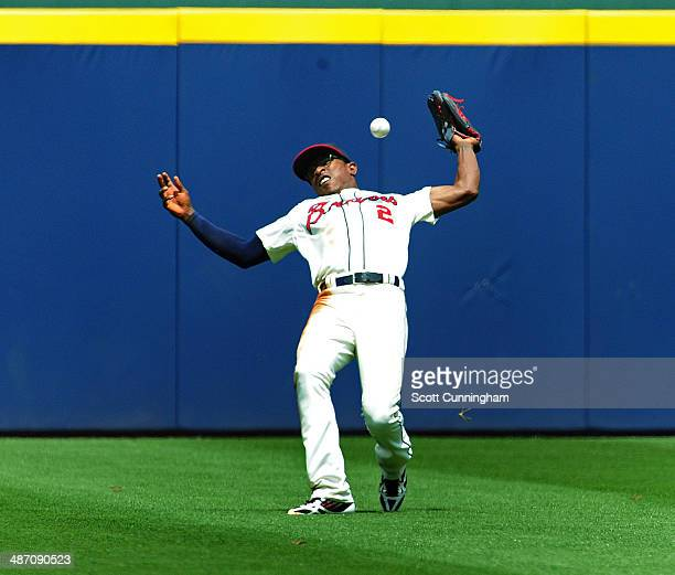 B J Upton of the Atlanta Braves loses a fly ball in the sun during the 2nd inning against the Cincinnati Reds at Turner Field on April 27 2014 in...