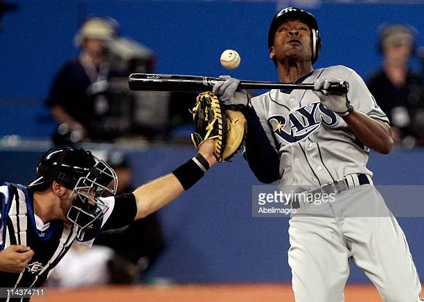 J Upton of the Tampa Bay Rays gets hit by a Jesse Litsch pitch in front of JP Arencibia of the Toronto Blue Jays during MLB action at the Rogers...