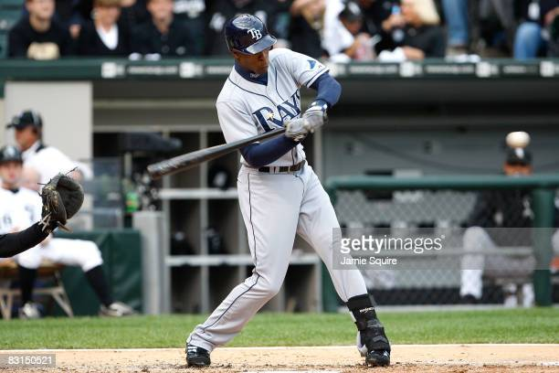Upton of the Tampa Bay Rays hits a solo home run in the top of the third inning against the Chicago White Sox in Game Four of the ALDS during the...