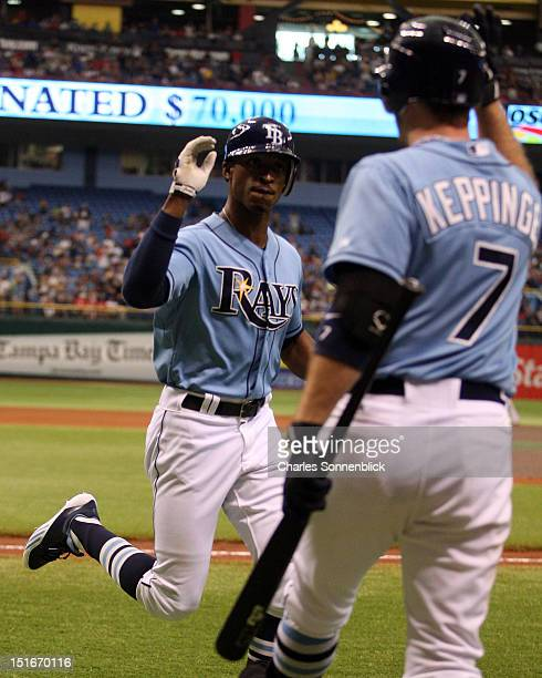 Upton of the Tampa Bay Rays hits his second home run and is congratulated by Jeff Keppinger against the Texas Rangers on September 9 2012 at...