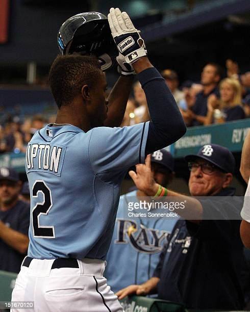 Upton of the Tampa Bay Rays hits his third home run and is congratulated by Joe Maddon against the Texas Rangers on September 9 2012 at Tropicana...