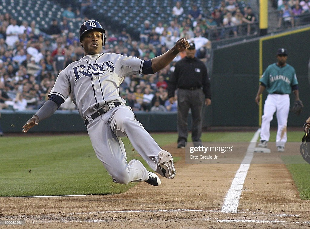 B.J. Upton #2 of the Tampa Bay Rays scores in the second inning on a double by teammate Casey Kotchman #11 against the Seattle Mariners at Safeco Field on July 29, 2011 in Seattle, Washington.