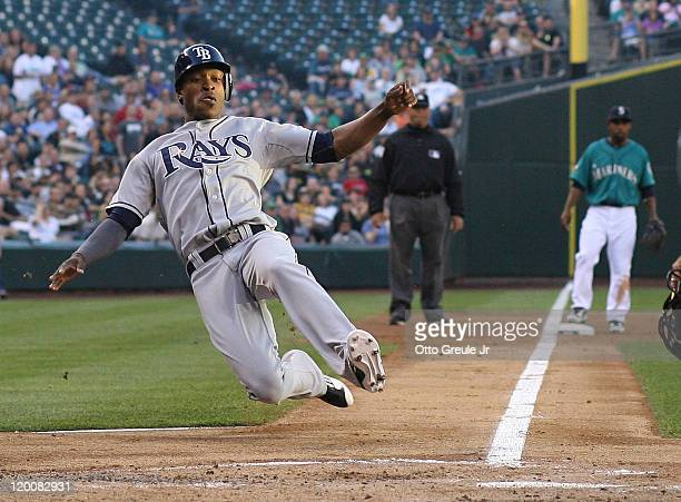 J Upton of the Tampa Bay Rays scores in the second inning on a double by teammate Casey Kotchman against the Seattle Mariners at Safeco Field on July...