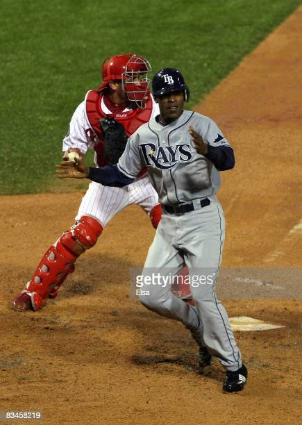 J Upton of the Tampa Bay Rays scores on a RBI single by Carlos Pena in the top of the sixth inning against Carlos Ruiz of the Philadelphia Phillies...
