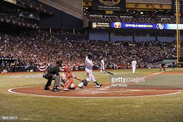 Upton of the Tampa Bay Rays singles on a line drive in the bottom of the second inning during game two of the World Series between the Tampa Bay Rays...