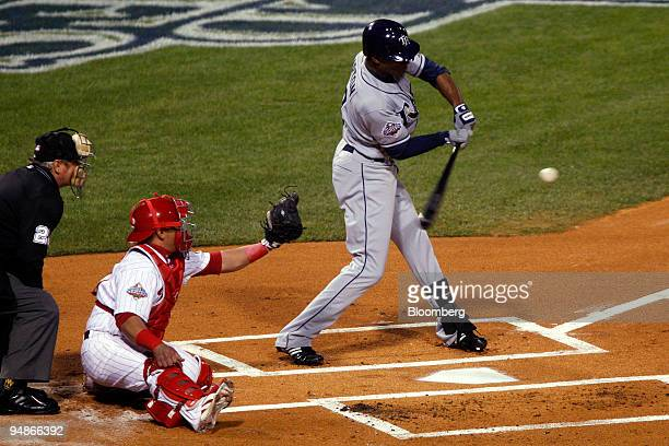 J Upton of the Tampa Bay Rays takes a pitch against Joe Blanton of the Philadelphia Phillies in the first inning of game four of the Major League...