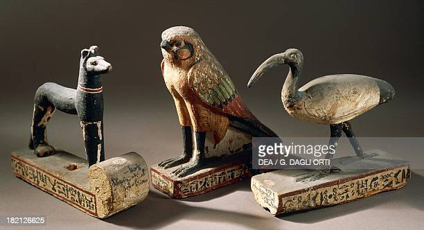 Upuaut as a jackal Horus as a falcon and the sacred ibis as Thoth the bases bear inscriptions of the priests dedicated to Amun procession statuettes...