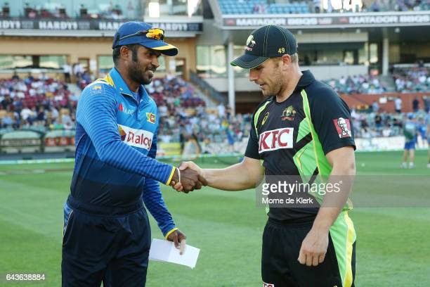 Upul Tharanga of Sri Lanka and Aaron Finch of Australia shake hands after completing the coin toss before the International Twenty20 match between...