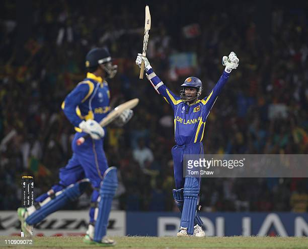 Upul Tharanga of Sri Lanka celebrates reaching his century and hitting the winning runs during the 2011 ICC World Cup QuarterFinal match between Sri...