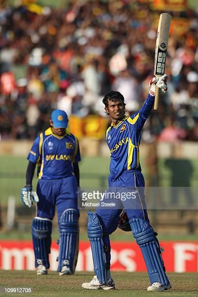 Upul Tharanga of Sri Lanka celebrates reaching his century during the Sri Lanka v Zimbabwe 2011 ICC World Cup Group A match at the Pallekele Cricket...