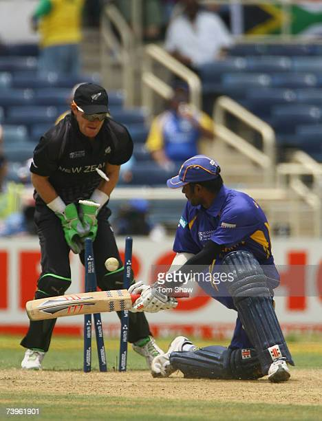 Upul Tharanga of Sri Lanka is bowled out duing the ICC Cricket World Cup Semi Final match between Sri Lanka and New Zealand at Sabina Park on April...