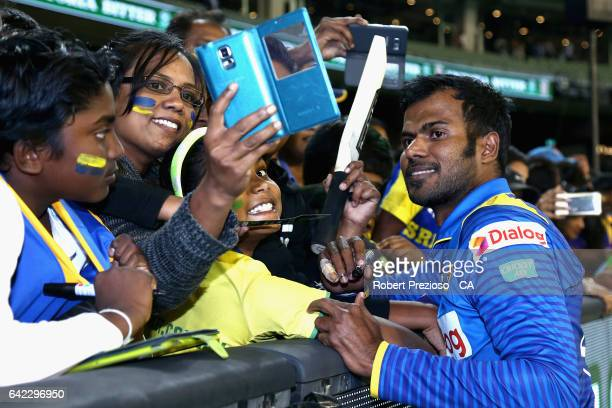 Upul Tharanga of Sri Lanka poses for fans during the first International Twenty20 match between Australia and Sri Lanka at Melbourne Cricket Ground...