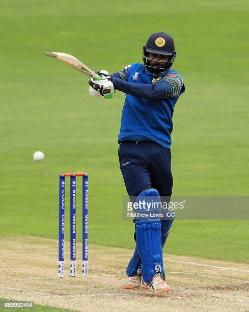 Upul Tharanga of Sri Lanka pulls the ball towards the boundary during the ICC Champions Trophy Warmup match between New Zealand and Sri Lanka at...