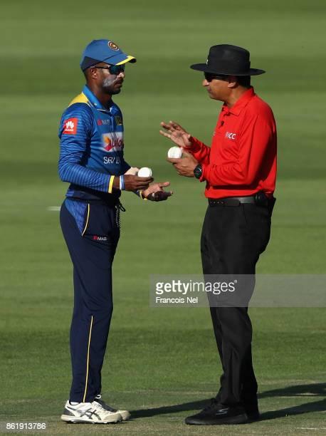 Upul Tharanga of Sri Lanka speaks to Umpire Shozab Raza during the second One Day International match between Pakistan and Sri Lanka at Zayed Cricket...