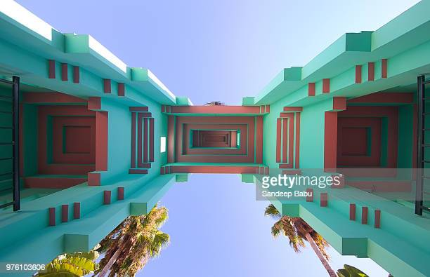 upward view at architectural details of building on sunny day, palm court, los angeles, usa - town hall government building stock pictures, royalty-free photos & images